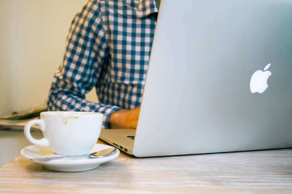 businessman-coffee-and-macbook-pro